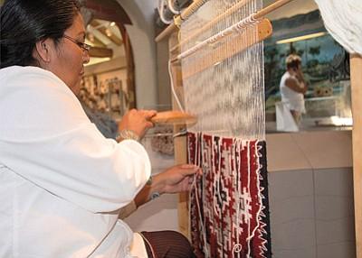 Weaver Vivian Descheney demonstrates her weaving techniques. Photo/Michele Mountain