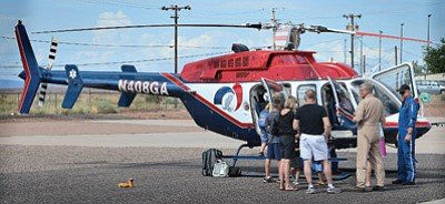 A Guardian Angel helicopter crew explains how the helicopter works to fly-in attendees. Photo/Todd Roth