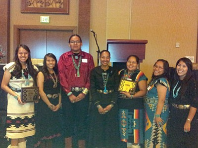 Navajo Nation President Ben Shelly presents Stephanie Geneeha with the Chief Manuelito Scholarship academic award. Geneeha is the 2013 Tuba City High School Salutatorian and a winner of the Gates Millenium Scholarship. Photo/Rosanda Suetopka Thayer