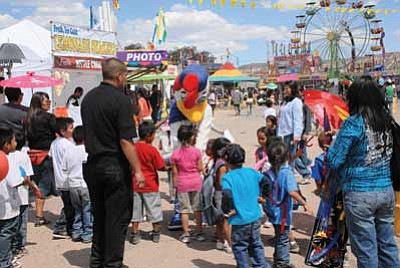 Children walk down the midway during Navajo Nation Fair Kids Day Sept. 6, 2012. Photo/Geri Hongeva