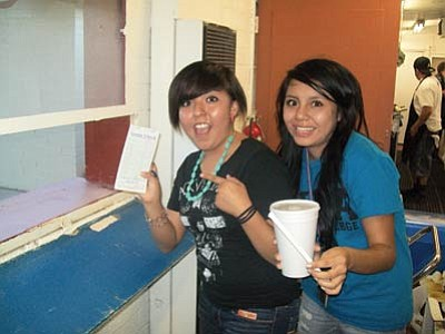Shenaya Featherhat and Amber Yazzie fill an order. Submitted photo