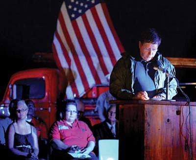 Winslow Mayor Robin Boyd recites a 9-11 poem. Photo/Todd Roth