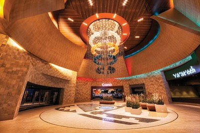 Twin Arrows Navajo Casino Resort was named the top Native American casino at the Global Gaming Expo Conference Sept. 26. Top: a custom chandelier in the casino's rotunda depicts the vertical rise of the people through each world.  Submitted photo