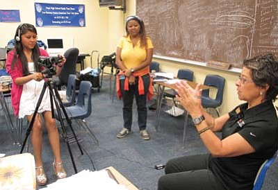 Hopi High journalism student Randi Lomayestewa videos Anita Luera as Ivana Braga looks on. Photo/Stan Bindell