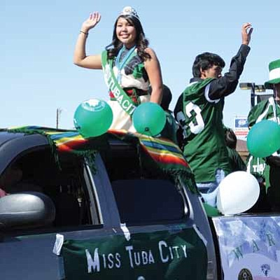 2013 Miss Tuba City High School Kristin Furcap of the Hopi and Navajo tribes, waves and smiles over the course of the Tuba City High School Homecoming Parade route on Oct. 11.