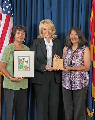 From left: Frances Quotskuyva, Arizona Governor Jan Brewer and artist Darlene James. Submitted photo