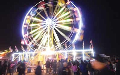 A ferris wheel lights up the sky during the 2012 Western Navajo Fair in Tuba City. Photo/Rosanda Suetopka Thayer