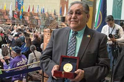 Hopi Chairman LeRoy Shingoitewa displays the Hopi tribe's Congressional Gold Medal at the National Museum of the American Indian Nov. 20. Photo/Chad Garland