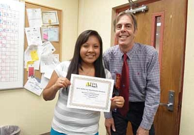 Ronelle Lomayaktewa displays her Arizona Intersholastic Press Association award with Hopi High Principal Glenn Gilman.