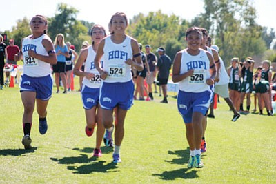 "Hopi High School girls cross country team members warm up before the Arizona state championship race at Cave Creek Golf Course in Phoenix Nov. 9. Pictured from left: Sonya Sahmea, Kaitlin Billy, Christen Ben and Claryn ""Mighty Mouse"" Josytewa. Stan Bindell/NHO"