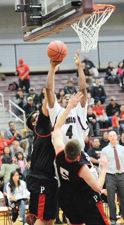 Demetrius Gamez powers past Page defenders to put two more points on the board. Photos/Todd Roth