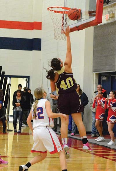 Lady Bulldogs co-captain Shandiin Armao scores against Holbrook during Winslow's Dec. 10 victory. Photo/Todd Roth