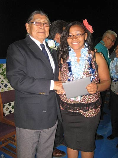 Albert Sinquah honors Ariana Soonhafyah at last year's promotion ceremony. Sinquah is the new interim superintendent at Hopi Jr./Sr. High School. Photo/Stan Bindell