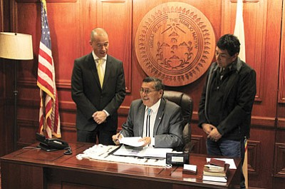 President Ben Shelly signs legislation clearing the way for Navajo Transitional Energy Company to buy Navajo Mine located on the Navajo Nation. Shelly said the future economic stability of the Navajo Nation hinged on its passage. Photo/Rick Abasta