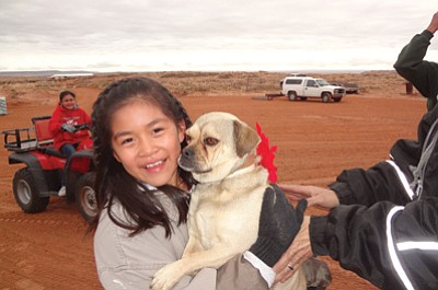 Caris Begaye and her new rescue puppy Corky. Submitted photo