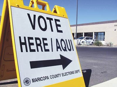 A voting sign outside the Maricopa County Recorder's Office early tabulation center during the 2012 general election. Photo/Natasha Khan