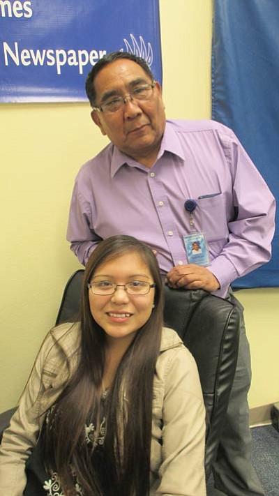 "Hopi Junior High Principal Harvey Honyouti with Hopi High student Keanna ""Cookies"" Speen. Photo/Stan Bindell"