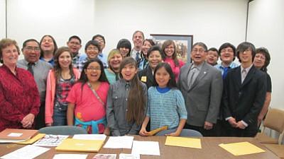 Students from Hopi High pose with Arizona State Representative Jamescita Peshlakai. Photo/Stan Bindell