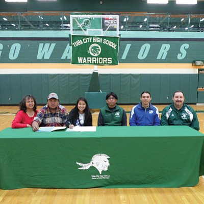 Diné College signs Tuba City High cross country runner Chelsea Sheppard to a scholarship for fall 2014. From left: Virginia and Nino Sheppard (parents), Chelsea Sheppard, Tuba City cross country head coach Arvis Myron, Diné College Race Director Shaun Martin and Tuba City Athletic Director Jamie Roe. Photo/Rosanda Suetopka Thayer