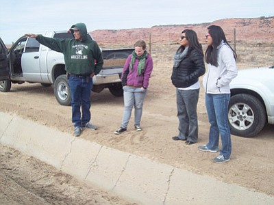 Frank Begay shows Johns Hopkins Center for American Indian Health (CAIH) Feast for the Future program staff an irrigation ditch that needs to be cleaned. Submitted photo