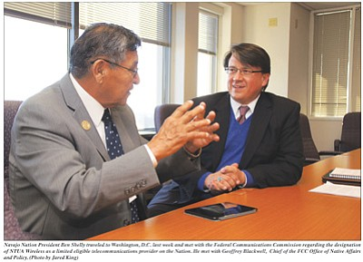 Navajo Nation President Ben Shelly meets last week with Geoffrey Blackwell, chief of the Federal Communications Commission Office of Native Affairs and Policy, regarding the designation of Navajo Tribal Utility Authority Wireless as a limited eligible telecommunications provider on the Nation. Photo/Jared King
