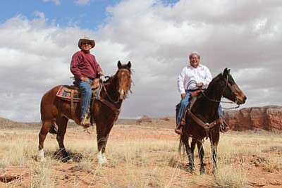Navajo Nation Council Delegate Walter Phelps (left) and Speaker Johnny Naize tour the Bennett Freeze area on horseback Feb. 27. Submitted photo
