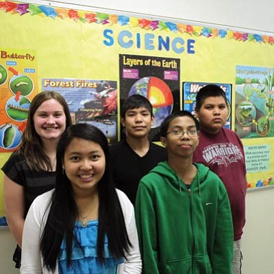 2014 Tuba City Junior High School Science Fair Winners. Back row from left:  Meaghan Moran, Marison Bilagody and Shane Tallman. Front from left: Mary Ardita and Edick Nuesca. Photo/Rosanda Suetopka Thayer