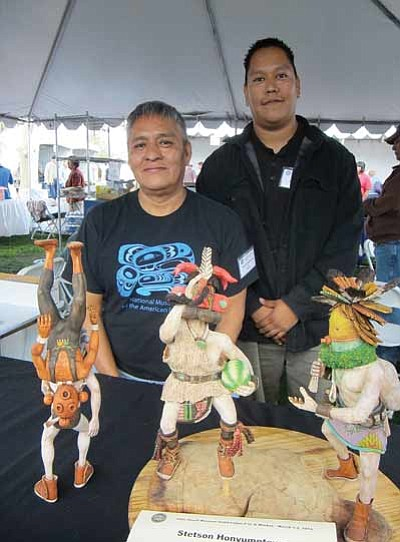 Stetson Honyumptewa (left) displays his kachina dolls at the 56th annual Heard Museum Guild Indian Fair and Market. Right: Honyumptewa's son, Aaron Gene Honyumptewa.Katherine Locke/NHO