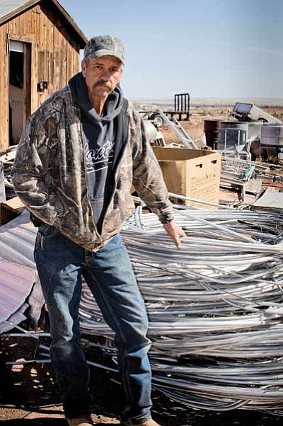 Maverick Recyclers Manager Mike, with a coil of clean aluminum wire. Photo/Todd Roth