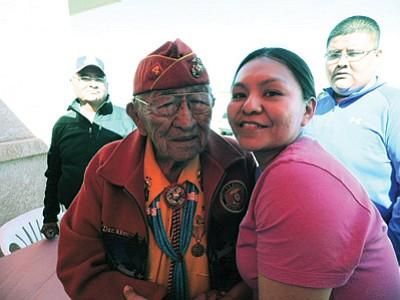 Navajo Code Talker Dan Akee greets Air Force Staff Sgt. Joy Hollonquest in Tuba City at her homecoming celebration April 6. Photo/Rosanda Suetopka Thayer