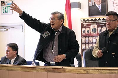 Navajo Nation President Ben Shelly reports to the Dzil Yijiin Regional Council on April 3 at Black Mesa Chapter House that the Nation will receive a $1 billion bankruptcy settlement for abandoned uranium mine cleanup from Kerr-McGee. He said the settlement was a major victory for the Navajo Nation and that the remaining abandoned mines still need money for cleanup. Photo/Rick Abasta