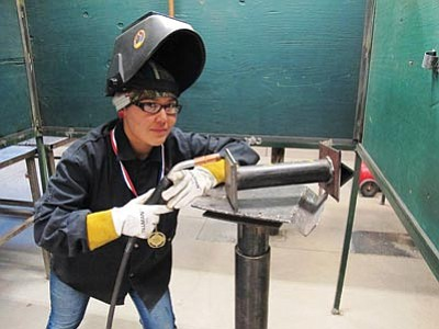 April Bracker, senior at Tuba City High recently won First Place in the SkillsNATIVE (Northeast Arizona Technological Institute of Vocational Education) besting 16 student welding competitors from eight other area high schools.  Photo/Rosanda Suetopka Thayer
