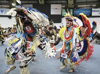 Dancers perform during one of the Grand Entries at the 2014 Powwow at the Walkup Skydome on the campus of Northern Arizona University April 12-13. Loretta Yerian/NHO
