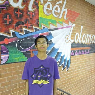Edick Nuesca, an eighth grade student at Tuba City Junior High School, recently took second place in the Arizona State Science Fair at the Phoenix Convention Center. Photo/Rosanda Suetopka