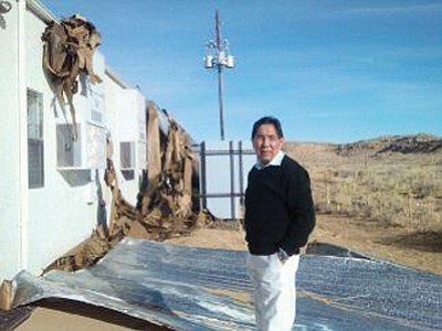 Hopi Tribal Chairman Herman Honanie visits the wind damaged Department of Economic Security office in Kykotsmovi, Ariz. High winds tore the roof off the office March 30. Submitted photo