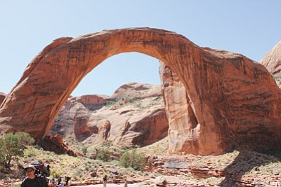 Hikers young and old make their way past Rainbow Bridge National Monument in Utah. This year will be the 32nd annual hike that Earl Riggs leads. Riggs said the hike is a way for younger Navajos to connect with their culture. Submitted photo