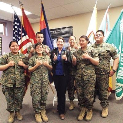Arizona Congresswoman Ann Kirkpatrick (Democrat) visits with members of the Tuba City High School ROTC program April 14. Photo/Rosanda Suetopka