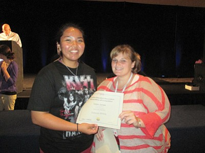 Journalism Education Assocation official Lacey Hatfield  presents Hopi High radio student Lexie James with the  editorial writing third place award at the Journalism Education Association Convention April 10-13 at the Hilton San Diego Bayfront. Photo/Stan Bindell
