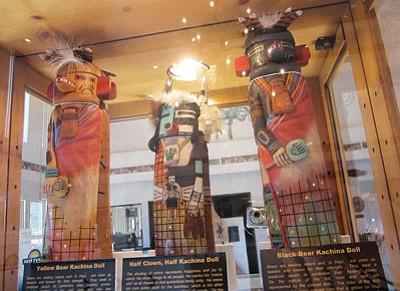 Above: Hopi Kachina dolls on display at the Consignment Art Gallery at the Days Inn Kokopelli in Sedona, Arizona. Below: artwork made by Hopi artists on display. Katherine Locke/NHO