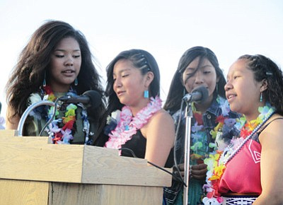 From left: Stacy Charley, Kaylen Lomayestewa, JoAnnika Mana Honwytewa and Kylee Kewanimptewa sing the national anthem during the Hopi Junior High School graduation ceremony May 21. Stan Bindell/NHO