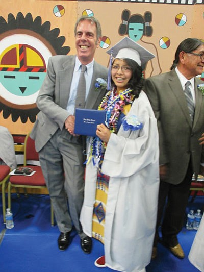 Hopi High Principal Glenn Gilman and  Shynell Begay are all smiles after the Hopi High graduation ceremony May 23. Stan Bindell/NHO