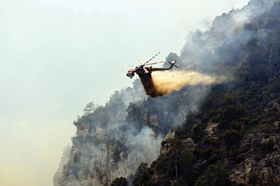A helicopter battling the Slide Fire in Coconino National Forest which cost $10.2 million to contain as it burned more than 20,000 acres. The fire, which started May 20, was fully contained this week. Mark Brady/U.S. Forest Service