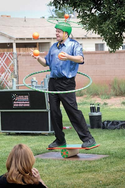 A juggler entertains on the Winslow Library lawn June 3 to kick off the Winslow Library's summer events schedule. Todd Roth/NHO