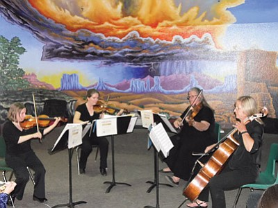 Classical string quartet Opus Ona performs in Tuba City during a Tuba City High School Spanish Club art night event. Rosanda Suetopka/NHO