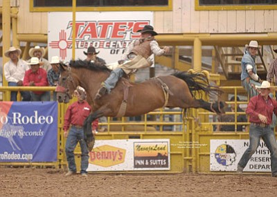 A rodeo contestant rides a bucking horse during a past rodeo in Window Rock, Arizona. Submitted photo