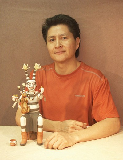 "17th annual Prescott Indian Art Market featured artist Joe Cajero, Jr. with his piece ""Smiling Koshare."" Submitted photo"