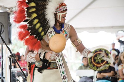 A member of the Tsootra Dance Group performs July 6 in the tent outside the Museum of Northern Arizona during the 81st annual Hopi Festival of Arts and Culture. Ryan Williams/NHO