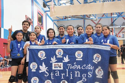 The 2014 Starlings Volleyball Club National Champions. Top row from left: coach April Clairmont, Jayda Chee, Kyra Slim, Amanda Goldtoot and Liliana Begay. Bottom row from left: Gracie Henderson, Gracee Curley, Kimmery Begay, Devynn Hatathlie, Carman Skacy and Naomi Goldtooth. Submitted photo