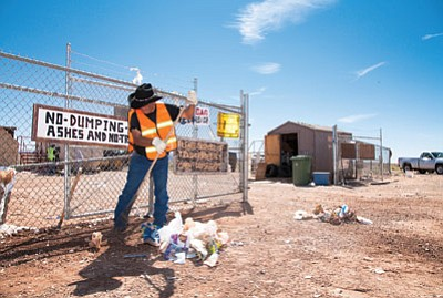 David Webster rakes up trash at the Cameron Transfer Station during a community cleanup day July 10. The station is closed. Chapter officials said they can't afford to keep the station open and need help from the Navajo Nation. Ryan Williams/NHO