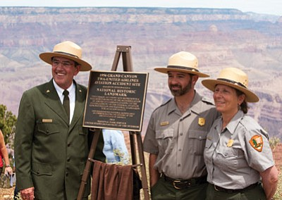 "Grand Canyon National Park Superintendent Dave Uberuaga  poses by the memorial plaque with Ian Hough and Janet Balson, two park employees who were instrumental in obtaining National Historic Landmark status for the accident site. Below: Mike Nelson, nephew of United Airlines passenger and author of ""We Are Going In...,"" reads a passage from his book during the dedication ceremony. NPS photos"